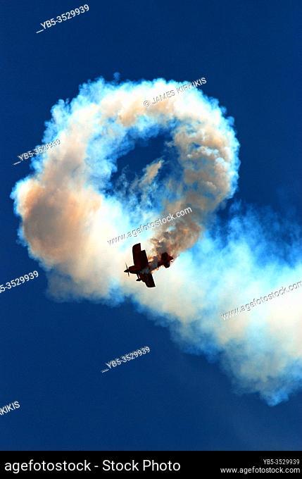 A stunt pilot demonstrates the loop the loop skills at an airshow