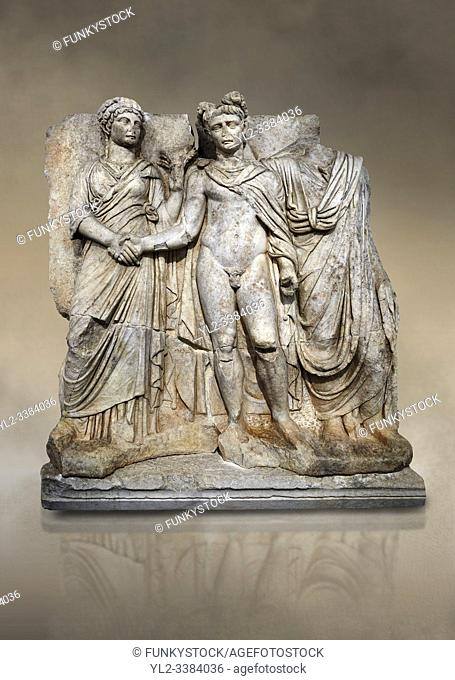 Roman Sebasteion releif sculpture of emperor Claudius and Agrippina, Aphrodisias Museum, Aphrodisias, Turkey. Against an art background.