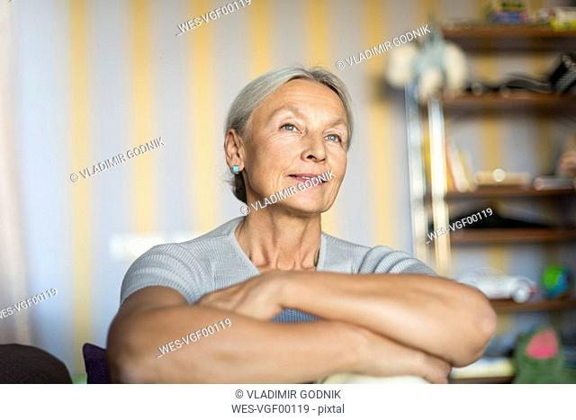 Portrait of smiling senior woman relaxing at home