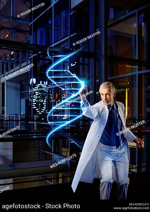 Male doctor light painting DNA in laboratory at hospital
