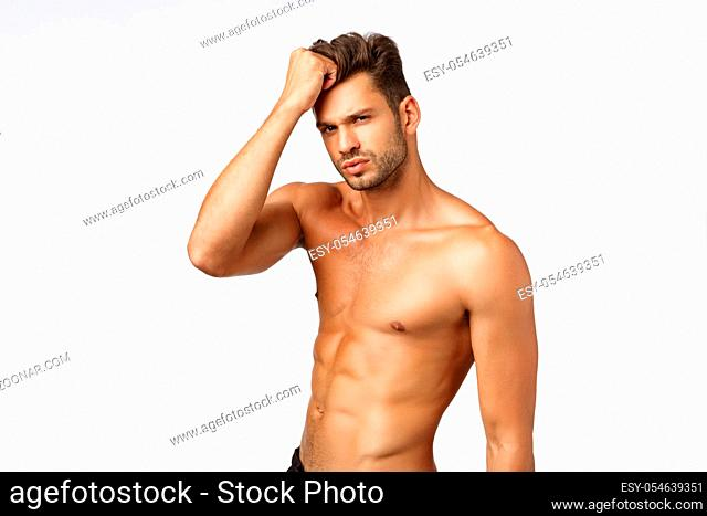 Advertisement, beauty and masculinity concept. Handsome, sassy and sexy young man promote healthy lifestyle, workout, bodybuilding or beauty haircare products