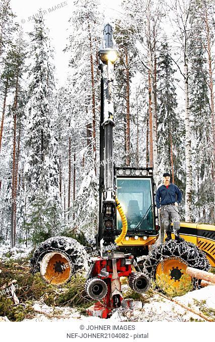 Man on forest machine