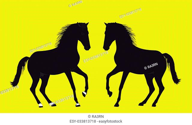 Silhouette of playing horses on a difficult yellow background