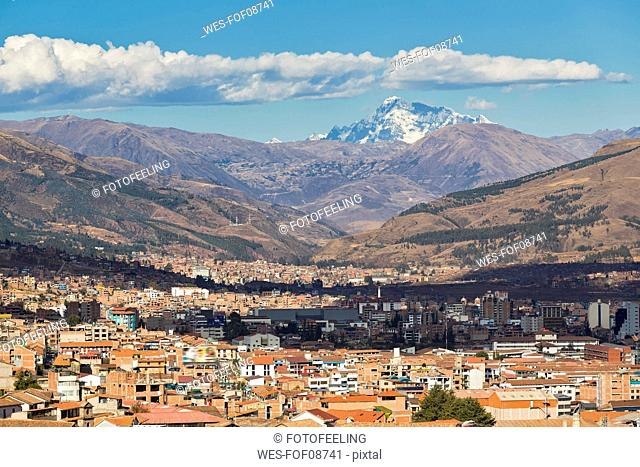 Peru, Andes, Cusco, cityscape and mountain Ausangate as seen from San Cristobal church
