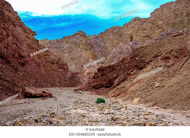Dirt road in dry multicolored mountains of Eilat
