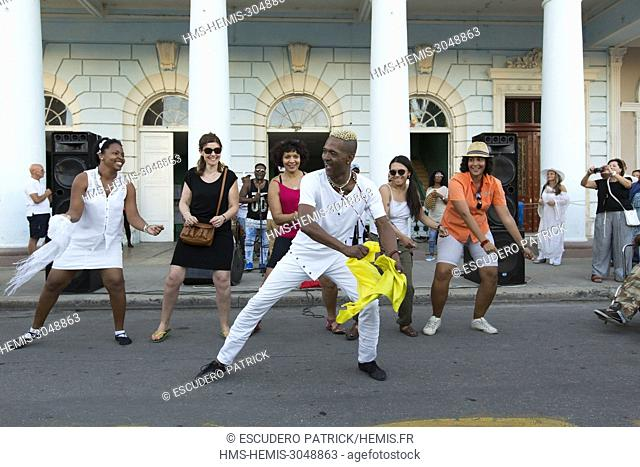 Cuba, Cienfuegos province, Cienfuegos, Historical center listed as World Heritage by UNESCO, dancers in front of the Palacio Ferrer on Jose Marti square