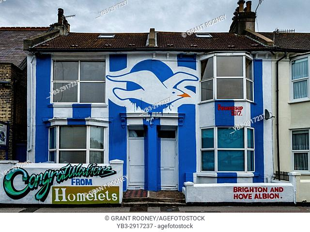 A House In The City Of Brighton Painted In The Colours Of The Local Football Team To Celebrate Promotion To The Premier League, Brighton, Sussex, UK