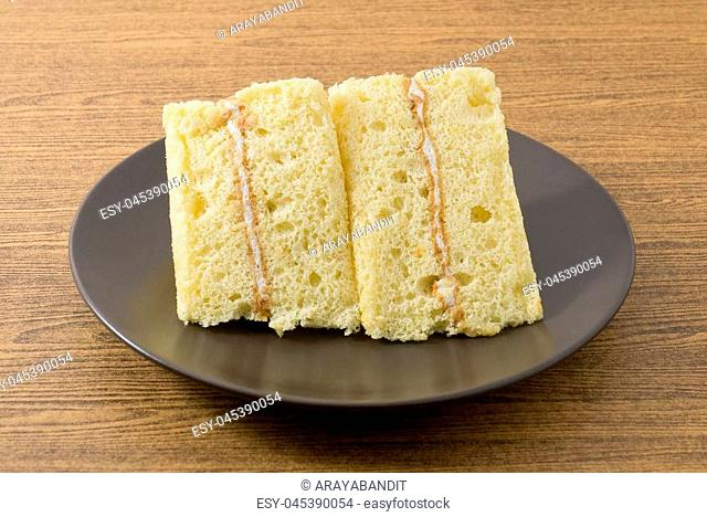 Snack and Dessert, Triangle Vanilla Chiffon Cake Made With Butter, Eggs, Sugar, Flour, Baking Powder and Flavorings