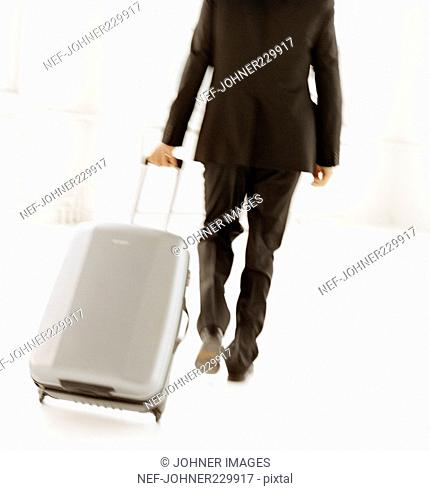 A man with a suitcase