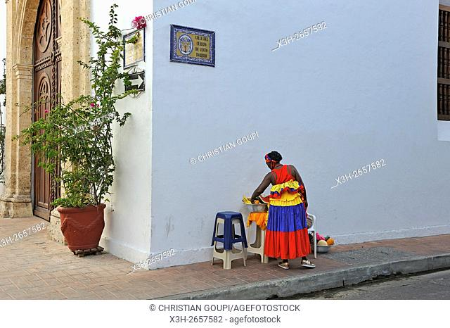 Palenque woman selling fruits beside the Church Santo Toribio in downtown colonial walled city, Cartagena, Colombia, South America