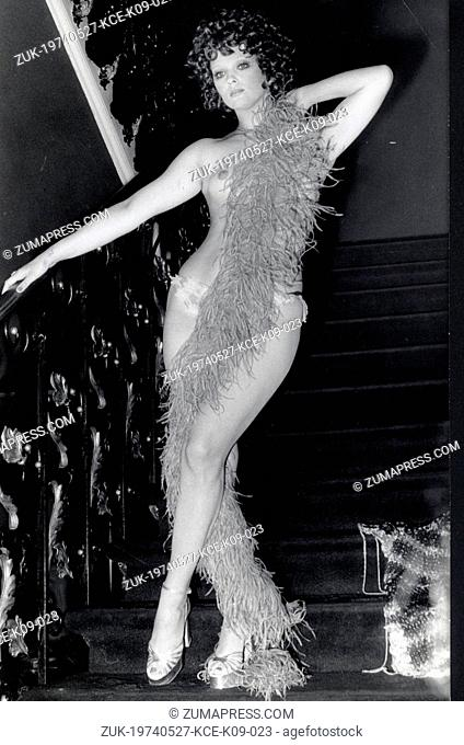 May 27, 1974 - Rome, Italy - Italian actress FEMI BENUSSI in a sexy strip scene on the staircase in a scene of the film, 'The Girl of Via Condotti' directed by...