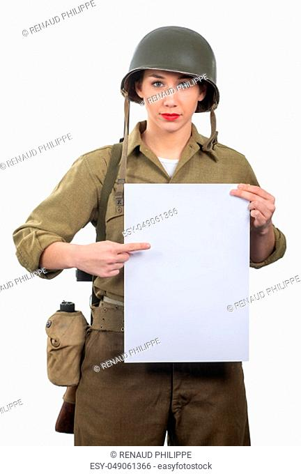 a young woman dressed in American ww2 military uniform showing empty blank signboard