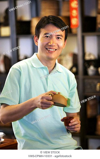 Chinese Man Drinking Tea