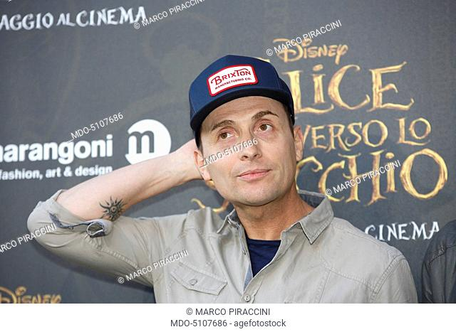 Italian TV celebrity, actor and mimic Angelo Pintus posing on the red carpet at the national premiere of the film Alice Through the Looking Glass staged at...