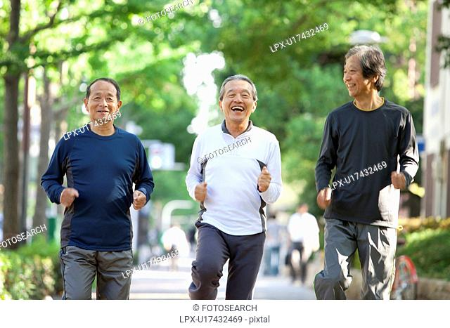 Senior men jogging