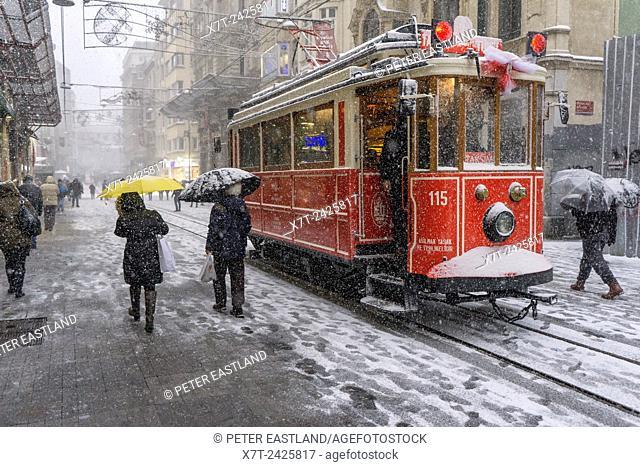 Taksim - Tunel tram in a winter snow storm. Istiklal Caddesi, Beyoglu, Istanbul, Turkey,