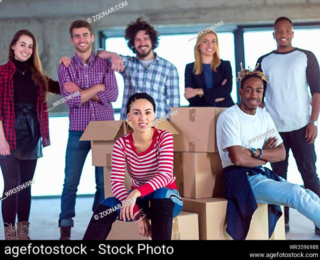 portrait of young multiethnic business team, architect and engineer on construction site while checking documents and business workflow in new startup office
