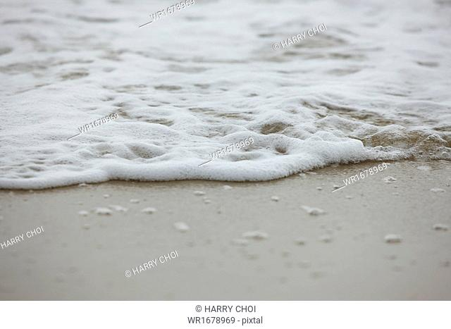 small waves crashing on the beach