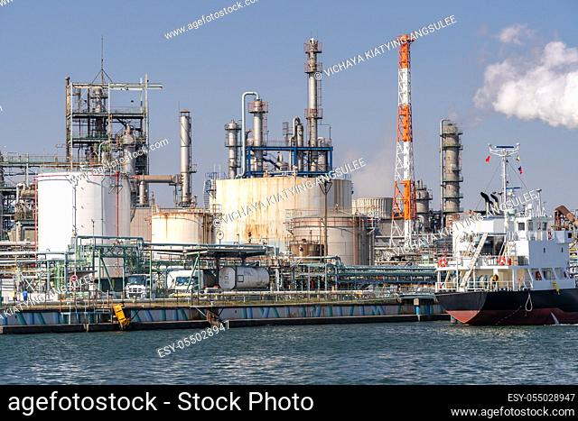 Chemical Factory plant with gas storage and structure of pipeline with smoke from smokestack in Kawasaki City near Tokyo Japan
