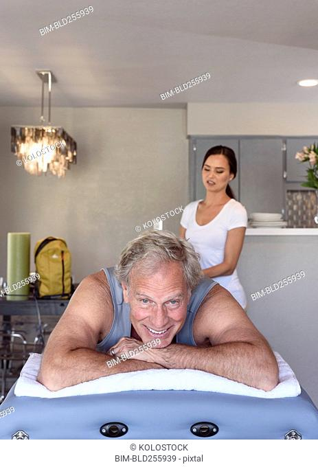 Physical therapist massaging man