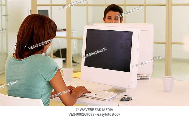 Casual business team working on computers