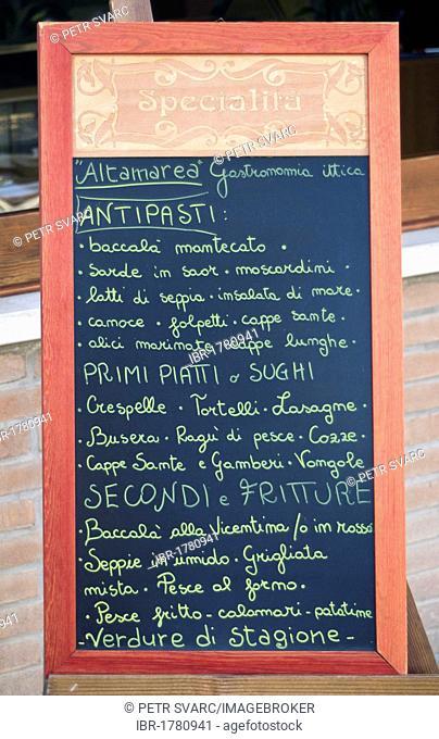 Handwritten blackboard menu sign outside Italian restaurant in Concordia Sagittaria, Veneto, Italy, Europe