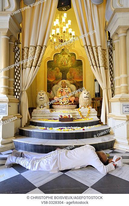 India, Uttar Pradesh, Vrindavan, ISKCON temple, Hare Krishna devotee prostrating before the statue of Guru Bhaktivedanta Swami Prabhupada