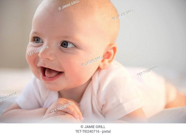 Portrait of laughing baby boy 2-5 months