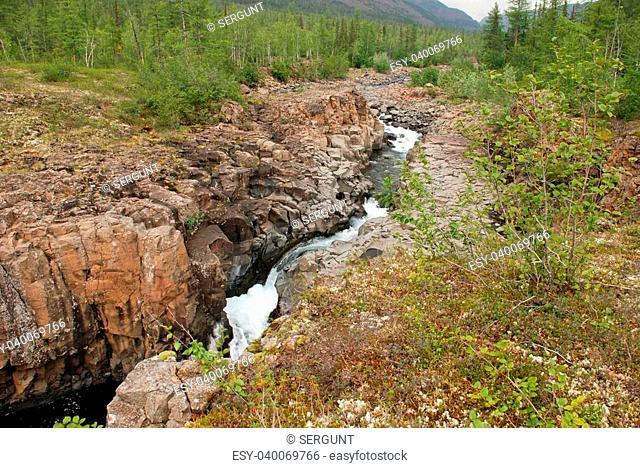 Rocky canyon of the mountain river. Russia, Taimyr Peninsula, Putorana plateau
