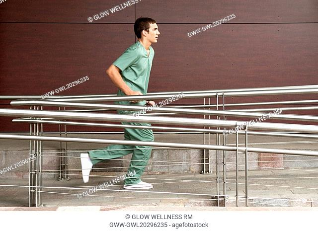 Male nurse running in a hospital