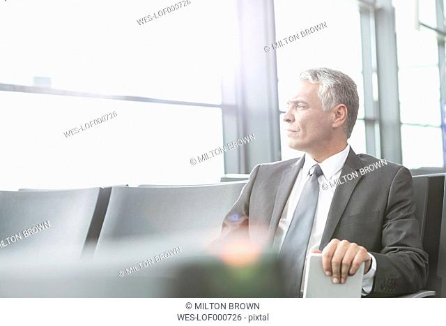 Businessman at airport departure lounge
