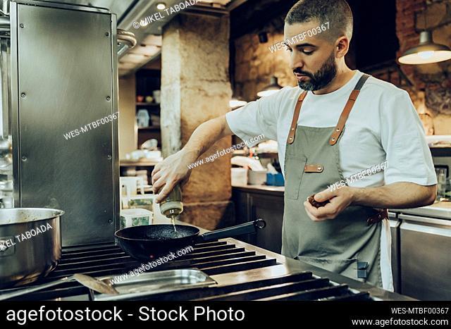 Chef preparing food in restaurant kitchen