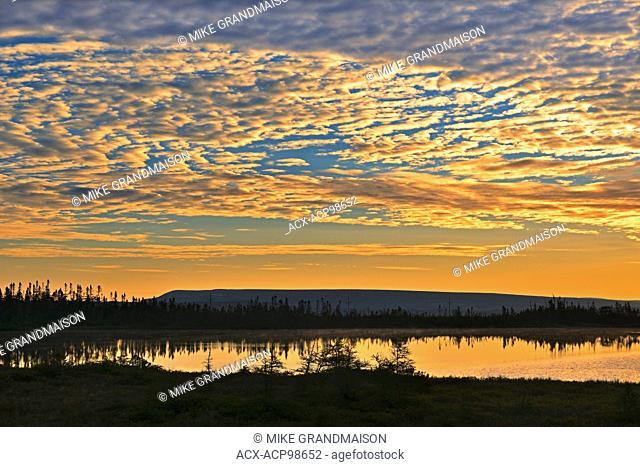 Clouds at sunset over pond Hawke's Bay Newfoundland & Labrador Canada