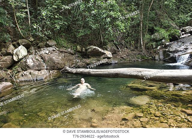 Relaxing in a natural swimming hole, Ko Tarutao Island, Thailand