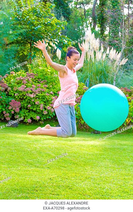 woman trains with ball outdoor