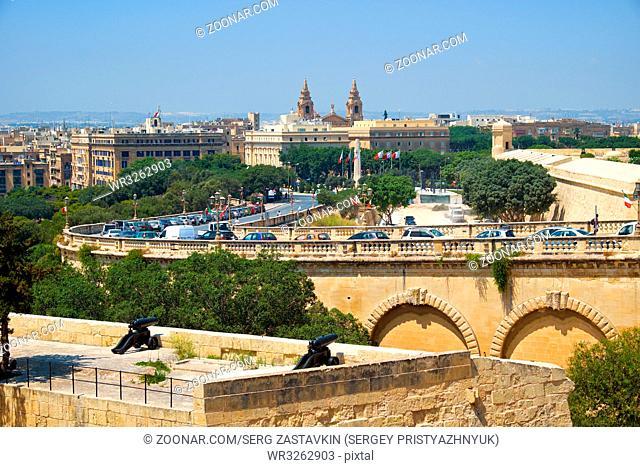 The view of Floriana with the top landmarks (Church of St Publius, War Memorial, Girolamo Cassar road) from the Upper Barrakka Gardens in Valletta, Malta