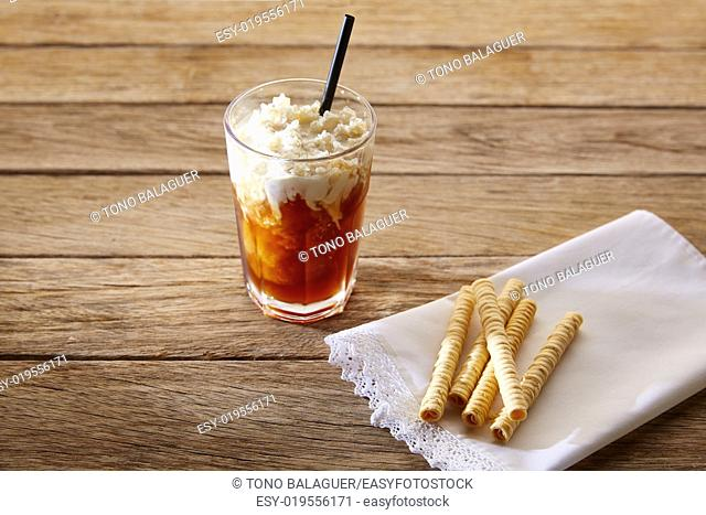 Coffee smoothie with wafers on vintage wood table