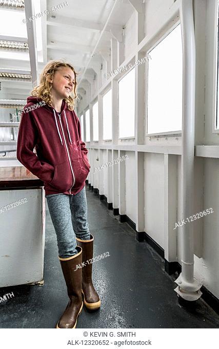 Young girl on the deck of the M/V Tustumena Alaska Marine Highway ferry, Homer, Southcentral Alaska, USA