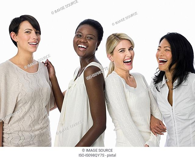 Four women laughing