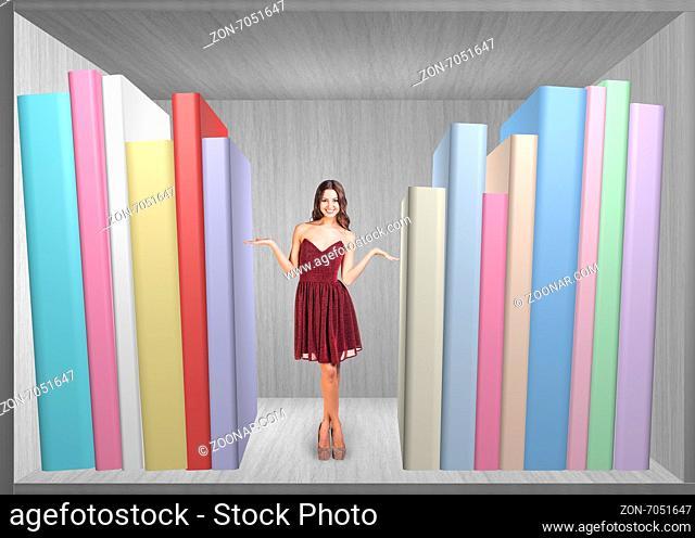 Pretty woman standing on book shelf in grey room