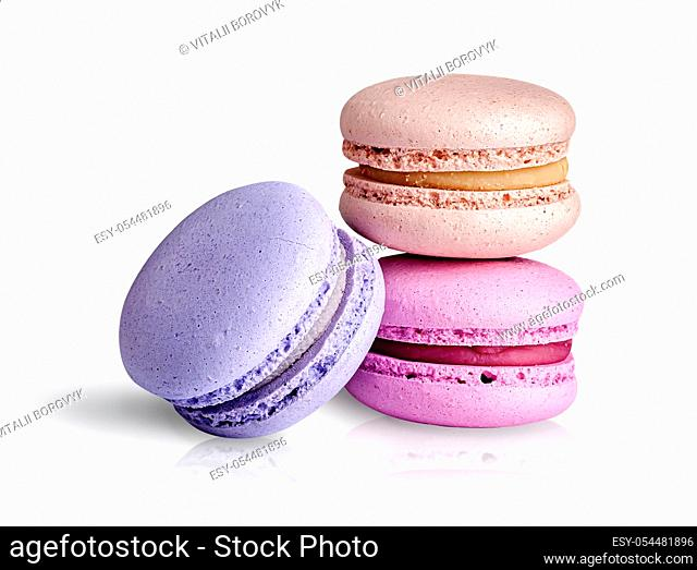 Two macaroon each other and one next on white background
