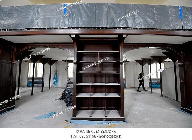 The dust-covered map reading room seen during a tour of the construction site of the Staatsbibliothek Unter den Linden, one of the main buildings of the...