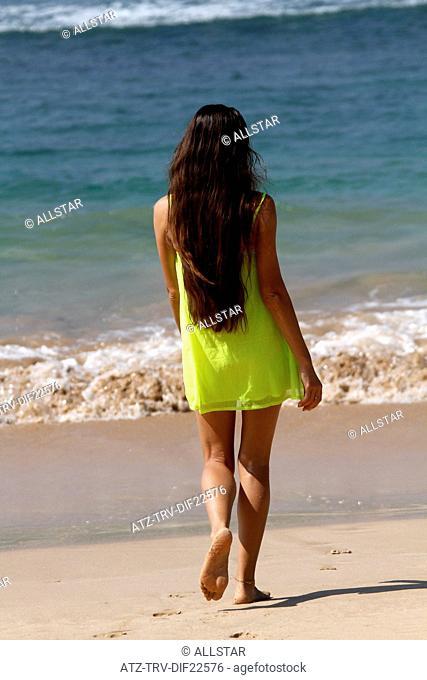 WOMAN IN YELLOW DRESS & INDIAN OCEAN; MIDIGAMA, SRI LANKA; 19/03/2013