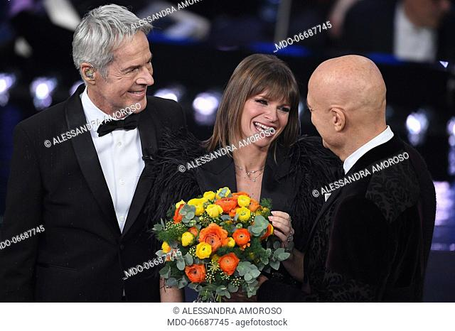Italian singer and host Claudio Baglioni, Italian singer Alessandra Amoroso and Claudio Bisio at the third evening of the 69th Sanremo Music Festival