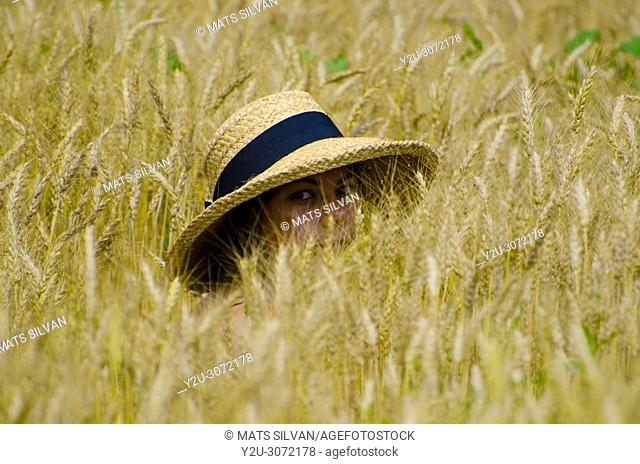 Woman in the Wheat Field with a Straw Hat and Looking in Locarno, Switzerland