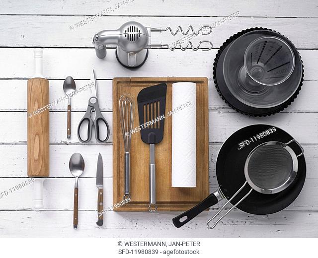 Various kitchen utensils for making a tart