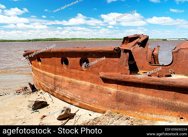 rusty ship on the shore of Ob river in Russia