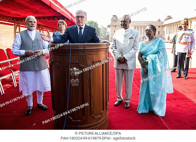 24 March 2018, India, New Delhi: German President Frank-Walter Steinmeier ..(C) and his wife Elke Buedenbender (2nd from left) being received with military...