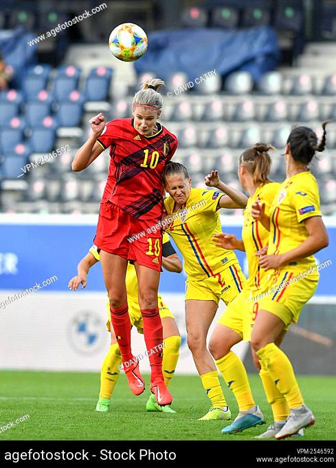 Belgium's Justine Vanhaevermaet and Romania's Olivia Oprea fight for the ball during a soccer game between Belgium's Red Flames and Romania