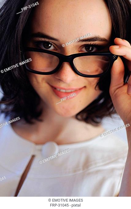 Brunette young woman with glasses smiling